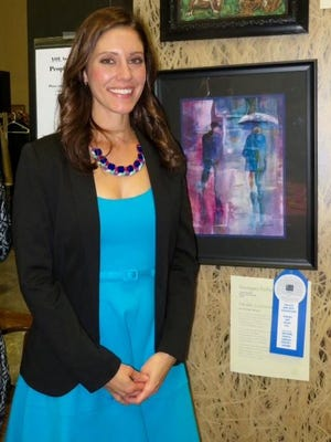 "Christine Torosian won the Milford Public Library Poetry Award for ""Parallel Existance."""