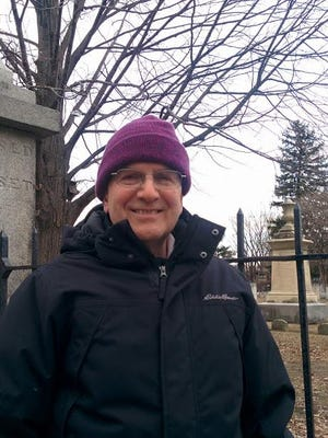Gary De Carolis, who operates Burlington History Tours, stands outside the Elmwood Avenue cemetery, the final resting place of Levi Allen, brother of Ethan and Ira Allen.