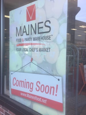 Sign outside the Maines Food & Party Warehouse in Greece.
