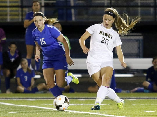 Abby Clark of Horseheads, left, and Logan Olmstead of Corning chase the ball during a Section 4 Class AA girls soccer semifinal Thursday night at Corning Memorial Stadium.