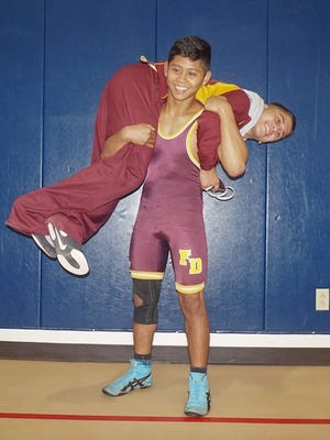 Father Duenas wrestler Cyril Maravilla is attempting to continue his two-season undefeated streak as he begins his senior year with the Friars. His training partner, junior Leonard Calvo, is along for the ride.
