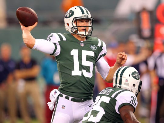 New York Jets quarterback Josh McCown (15) throws a pass against the Tennessee Titans during the first quarter of a preseason game at MetLife Stadium.