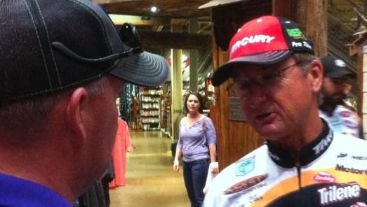 Bassmaster Elite angler Gary Klein visits with Brian Weatherford of Nacogdoches, Texas, at the Bossier City Bass Pro Shops on Friday.