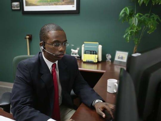 Edward Jones' financial adviser Robynne Henry works at his Dearborn office on Oct. 23, 2013. Edward Jones' financial adviser Robynne Henry works at his Dearborn office on Oct. 23, 2013.