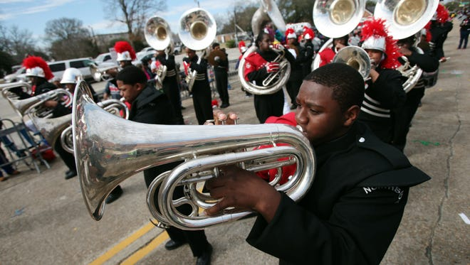 The Northside High School marching band performs as the 2015 Lafayette Mardi Gras Festival Parade rolls through Lafayette in 2015.
