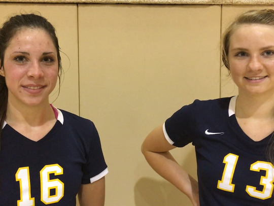 St. James juniors Emily Olsey, left, and Carson Ann