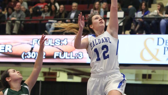 Haldane's Allison Chiera (12) goes up for two during