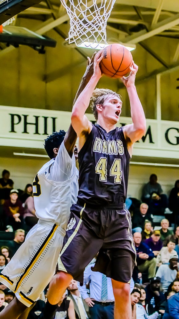 Holt's Jaron Faulds recently verbally committed to continue his basketball career at Columbia University. Faulds is one of the state's top prospects in the 2017 class.