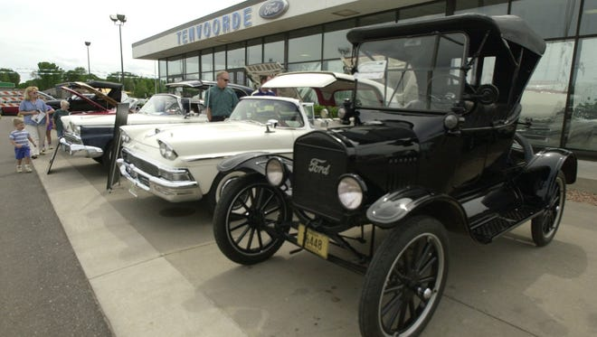 New and old Ford cars were on display outside Tenvoorde Ford when the St. Cloud business celebrated its 100th anniversary in June 2003.