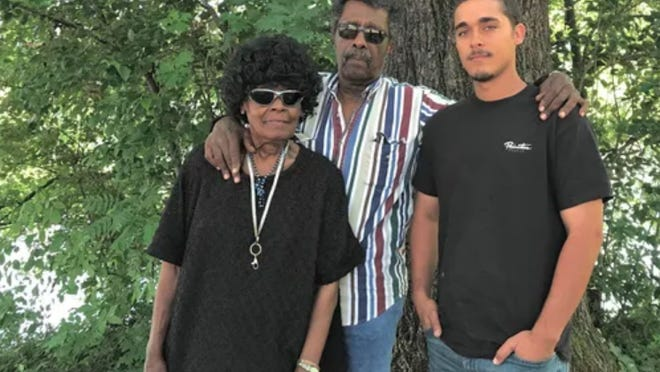 Earnestine and Leo Coleman of Redding pose with their grandson, also Leo Coleman, whose father, Leo Coleman Jr. was found hanged to death in an oak tree in Anderson in 1997.