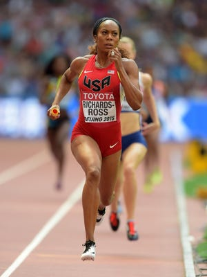 Sanya Richards-Ross runs the third leg on the U.S.  4 x 400 relay that won its heat during the IAAF World Championships in Athletics at National Stadium in Beijing on Aug. 29, 2015.