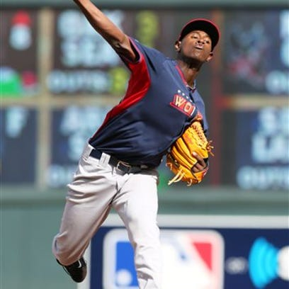 World's pitcher Luis Severino throws a pitch during