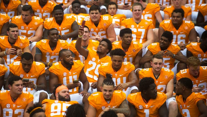 Evan Berry (29), takes a selfie as the 2016 Tennessee football team prepares for a group shot in Neyland Stadium during Media Day on Aug. 12, 2016.