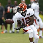 Cincinnati Bengals wide receiver Mohamed Sanu catches the ball during training camp downtown.