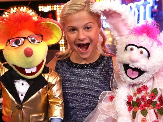 Darci Lynne Farmer with Oscar and Petunia, two of her characters.