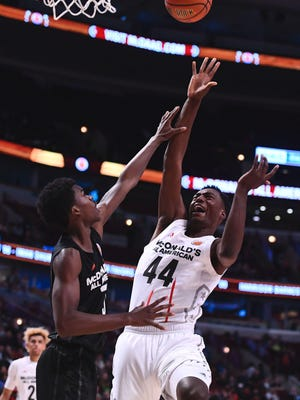McDonalds High School All-American center Brandon McCoy (44) shoots the ball as teammate Brian Bowen (bottom left corner) watches during the second half at the United Center. Michigan State coach Tom Izzo is trying to land both Saginaw native Bowen and McCoy to complete the Spartans' 2017 recruiting c lass.