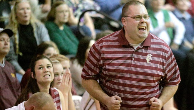 Cannon County High School girl's coach Michael Dodgen on the sidelines during the game against Livingston Academy at Cannon County , on Tuesday Jan. 14, 2014.
