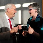 City Manager Linda Norris and Edwin Peterson, the 39th Chief Justice of the Oregon Supreme Court, speak before her farewell reception at the Salem Convention Center, on Thursday, March 26, 2015, in Salem.