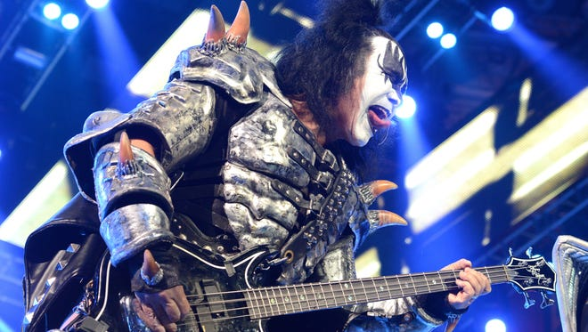 Gene Simmons of KISS breaks out the tongue during the opening of the band's Freedom to Rock Tour Wednesday night at the Resch Center.