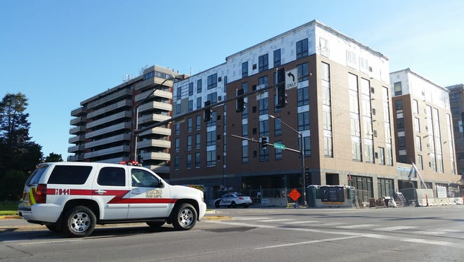 Authorities investigate a fatal construction accident on Friday, June 19, 2015. in Ames' Campustown district.