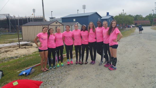 Elyse King, fifth from right, and the Roberson girls track team.