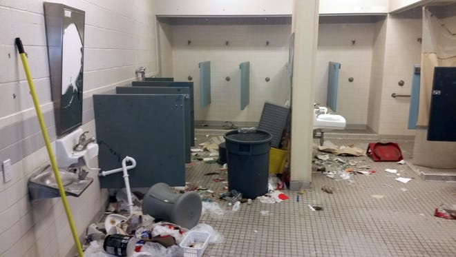 The governor's spokesman said much of the medium-security unit at the prison was uninhabitable, primarily because of destroyed porcelain toilets and sinks.