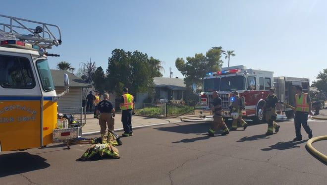 Firefighters were able to prevent a first-alarm fire from spreading to other homes near 75th Avenue and Peoria Drive on July 16, 2015.
