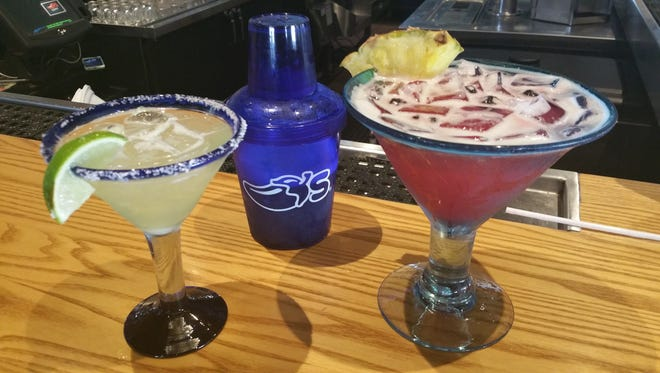 The platinum Presidente margarita with a Chili's shaker along side the blueberry and pineapple margarita at Chili's in Tamuning on April 14.