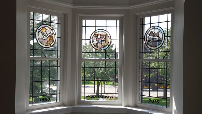 Stained-glass medallions formerly in the Hamilton Manufacturing headquarters office, were recently installed in Two Rivers City Hall.