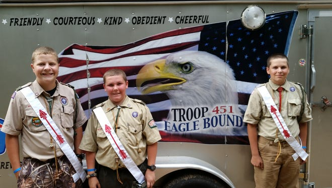 "Joseph Toboyek from left, Logan Kasat and Nicholas Stepen all from Troop 421, Kronenwetter, were selected this summer, by their fellow Scouts, for the ""call-out ceremony"" for the Order of the Arrow."
