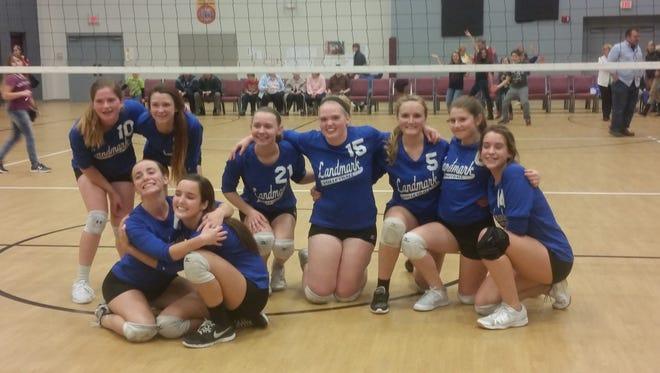 The Landmark Academy volleyball team celebrates a league title