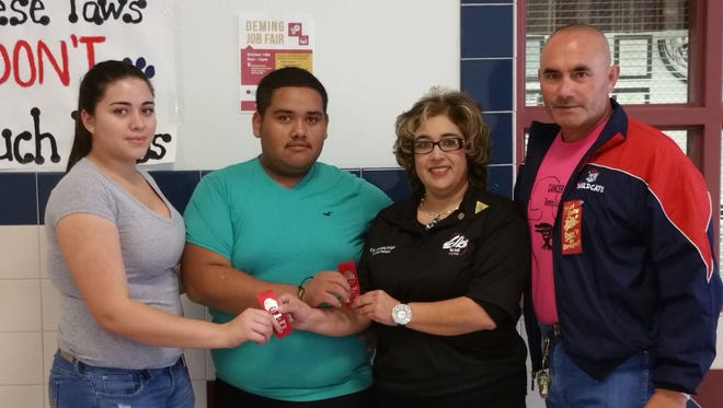 Pictured, from left, are seniors..Diana Nunez and Emmanuel Arroyo, with Deming Elks Lecturing Knight Yvonne Jasso-Perales and City of Deming Mayor Benny Jasso. Red Ribbons were distributed to all students in the Deming Public Schools in recognition of Red Ribbon Week, Oct. 23-31.