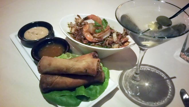 From left, crispy vegetable spring rolls, shrimp pad thai and a dirty martini from Roy's Restaurant in Pasadena, California.