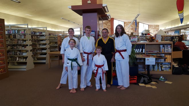 Sensei Daniel Reis, sixth-degree black belt, brought a group of his taekwondo students to the Great Things Are Happening event Nov. 15 at Marshfield Public Library. The students demonstrated various techniques in self-defense and taekwondo, along with several board breaks for onlookers. Among the students who participated were two family groups.