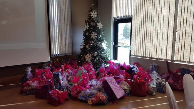 The 3rd Judicial District Attorney's Office worked with area groups to donate gifts to more than 90 children.