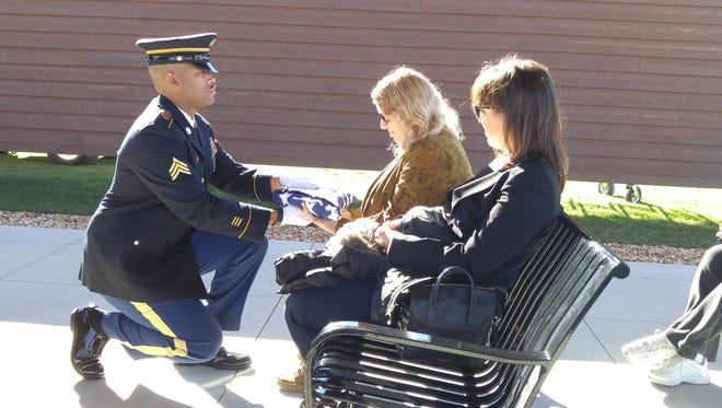 The American Flag (in these pics) is presented to Wendy and Tosca Dimatteo (daughter and granddaughter of Arnold) of Rochester New York.