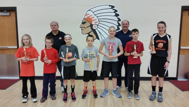 Mishicot-Tisch Mills Knights of Columbus members Pat Fencl and Al Kliment, back, stand with winners of the Knights' annual Free Throw Championship. From left are Allison Wilsmann, Anthony Butler, Melissa Wotachek, Hunter Trochil, Kailey Tulachka, Austin Fencl and Lacey Tauschek. Not pictured is Ethan Rauber.