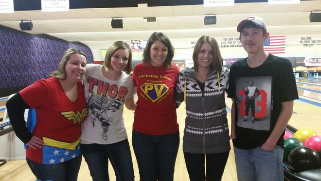 Team members at last year's Bowl for Kids' Sake pose at the alley. This fundraiser is the largest event for Big Brothers Big Sisters each year.