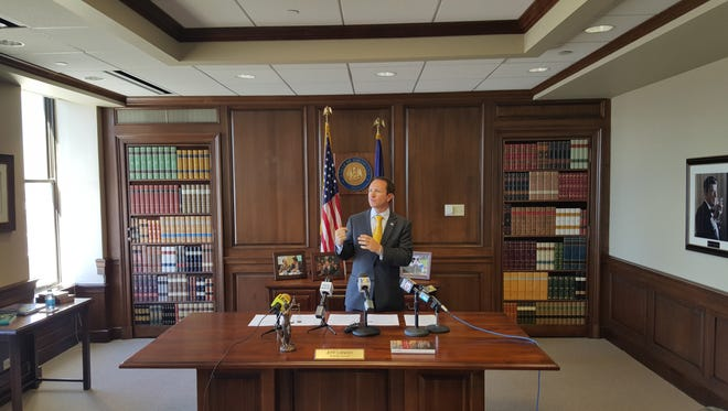 Attorney General Jeff Landry holding a press conference Thursday in his office in Baton Rouge.