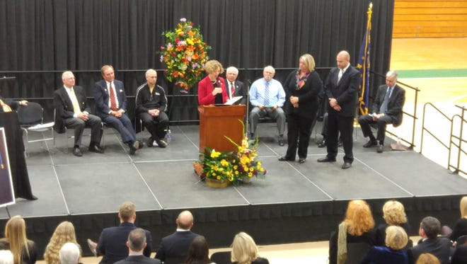 U.S. Rep. Susan Brooks, R-Ind., spoke at a memorial service for Hall of Fame high school football coach Jim Belden in Noblesville on Saturday, Feb. 27, 2016. With Belden's children standing nearby, Brooks read a tribute to the coach that will be entered into the Congressional Record.