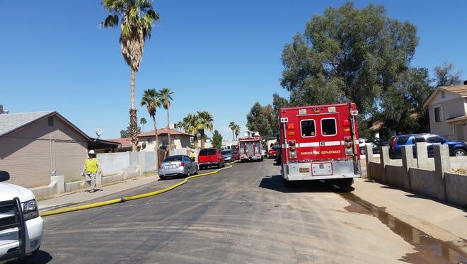 Fire crews working on scene of a fire in west Phoenix.