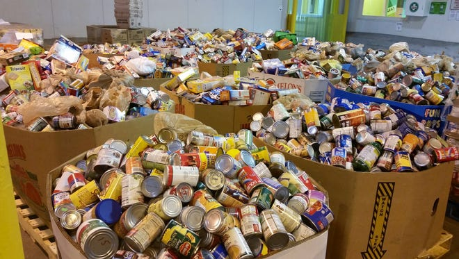 Some of the 87,198 pounds of food collected for Harvest Hope Food Bank during the 2015 Stamp Out Hunger campaign. This year's campaign will be on May 14