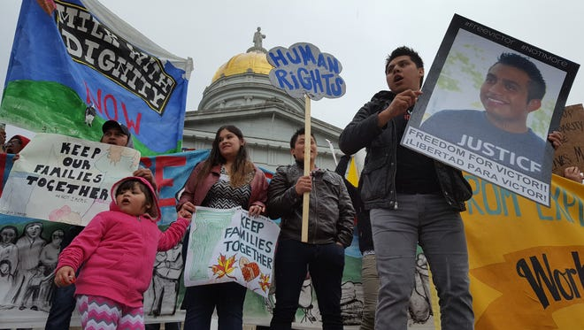 Supporters of Vermont-based immigration activist Victor Diaz rally in Montpelier on Sunday, urging federal authorities to release the Addison County dairy worker, who is a Mexican national.