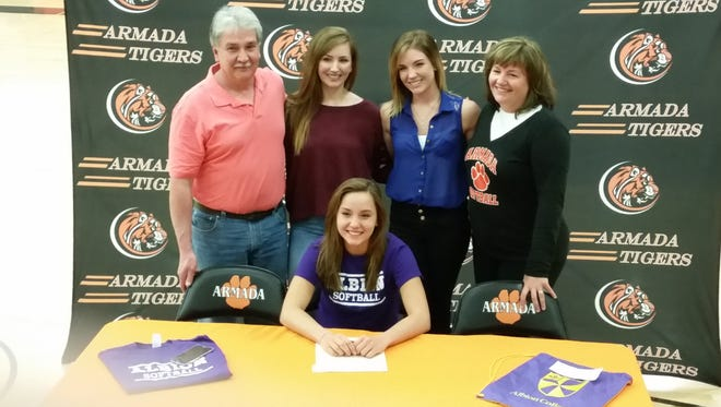 Madison Kortas signs to play softball at Albion College surrounded by her dad, Patrick (left), sisters Samantha and Katie (left center and right center, respectively) and mom, Laurie.