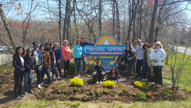 On April 14, 25 volunteers from Coldwell Banker's East Brunswick office beautified the entrance to Crystal Springs Aquatic Park.