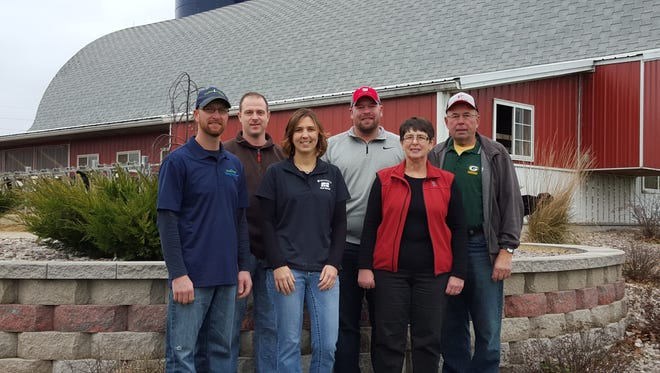 Vision-Aire Farms is operated by, from left, Travis Clark, Cory Tavs, Janet (Grade) Clark, David Grade, Sandy Grade and Roger Grade.  All are owners except Tavs who is hired to help with the milking.