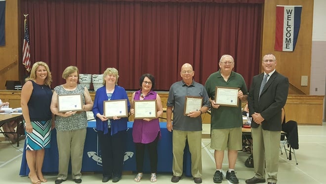 (From left) Franklin Township Board of Education President Stephanie Starr is joined by retirees Margery Walsh, Irene Korbach, Jiselle Knauss, William Carione and William Hargraves. At right is Superintendent Troy Walton.