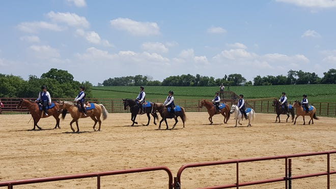 The Door County Rollers 4-H Drill Team enter the ring at the 13th annual Kettle Moraine Drill Team Competition.