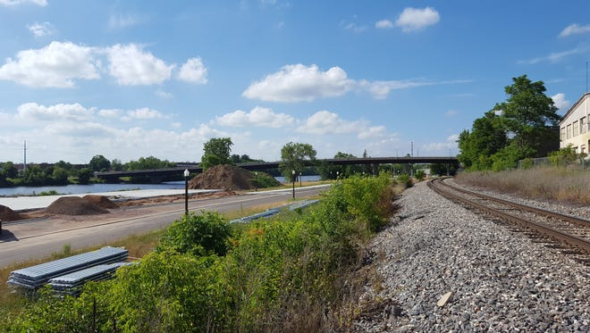 Development is well underway along the Wisconsin River, south of Bridge Street, in Wausau. Crews have poured the foundation for Wausau on the Water entertainment center (left), shown here on July 5, 2016.