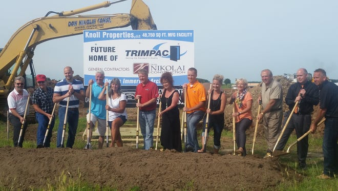 A groundbreaking ceremony was held earlier this month for a new 48,750-square-foot Trimpac manufacturing facility in the Stratford Industrial Park. Trimpac, which has a current facility in Marshfield, plans to move its operation to Stratford later this year. The company, which employees about 30 workers, is a manufacturer of custom architectural cabinetry and millwork. Pictured are Dennis Immerfall of Don Nikolai Construction, from left; Bud Suckow, president of the village of Stratford; Dan Wenzel of the Stratford Area Economic Development Foundation; Russ Nowack of Trimpac; Gail Yetter of Trimpac; Jed and Lisa Moore of Trimpac; Luke and Ashley Moore of Trimpac; Allie and Diane Knoll of Knoll Properties;  Jeff Lappe of Stratford State Bank; and Rob Nikolai of Don Nikolai Construction.